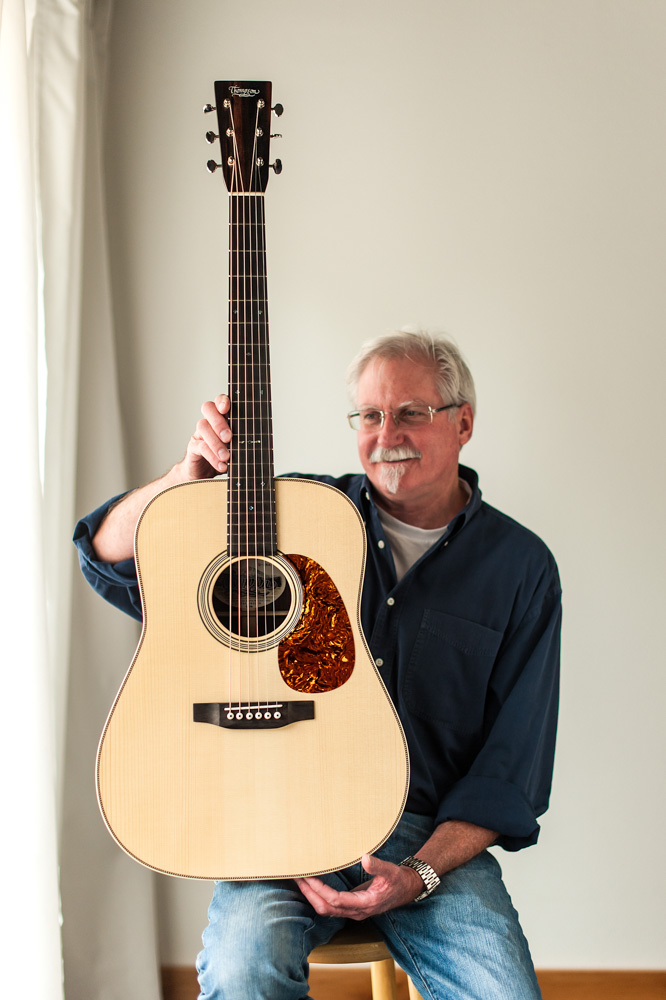 Preston Thompson holds east-indian-rosewood-guitar-dreadnought-1