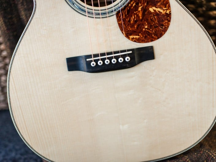 Preston Thompson Acoustic Guitars Brazilian Rosewood 14 Fret 000 acoustic guitar with custom abalone inlays. Body close