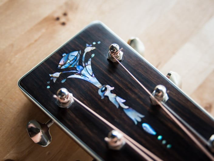custom inlay om acoustic guitar