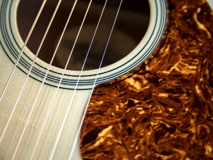 Acoustic dreadnought guitar handcrafted of mahogany back and sides with an adirondack top. 11