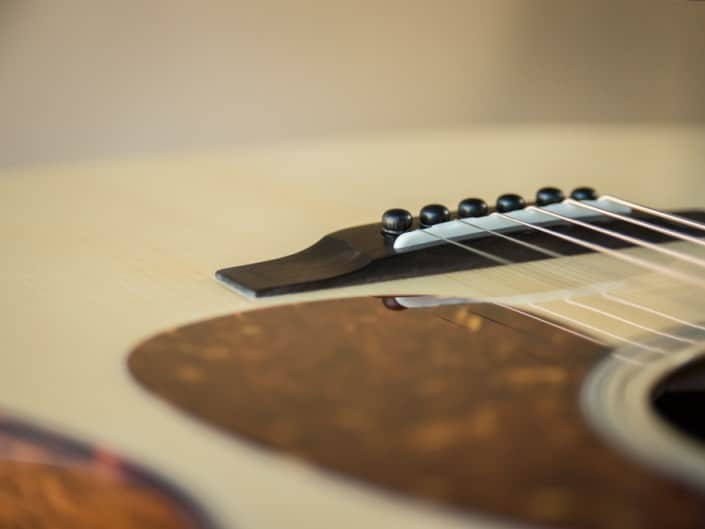 Acoustic dreadnought guitar handcrafted of mahogany back and sides with an adirondack top. 14