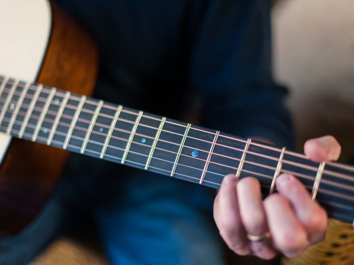 Preston Thompson plays Acoustic dreadnought guitar handcrafted of mahogany back and sides with an adirondack top. D Chord