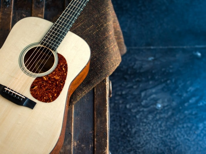 Acoustic dreadnought guitar handcrafted of mahogany back and sides with an adirondack top. 9