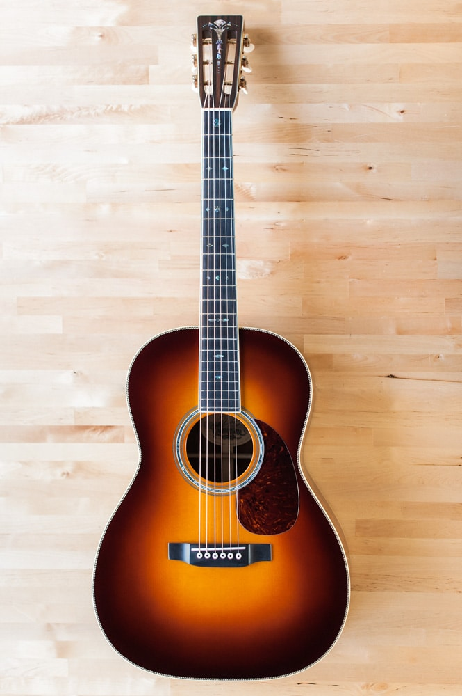 12 Fret 000 acoustic guitar handcrafted from Adirondack Spruce and Brazilian Rosewood.