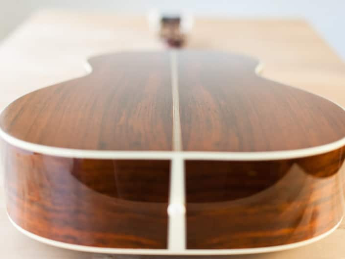 12 Fret 000 acoustic guitar handcrafted from Adirondack Spruce and Brazilian Rosewood. Side back