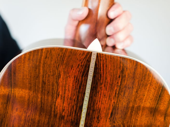 12 Fret 000 acoustic guitar handcrafted from Adirondack Spruce and Brazilian Rosewood. Heel up close