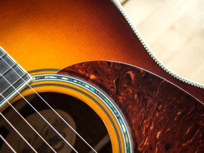 12 Fret 000 acoustic guitar handcrafted from Adirondack Spruce and Brazilian Rosewood. Side view
