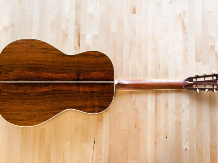 12 Fret 000 acoustic guitar handcrafted from Adirondack Spruce and Brazilian Rosewood. Back wood