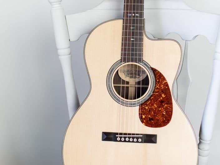 custom 12 fret 000 cutaway acoustic guitar