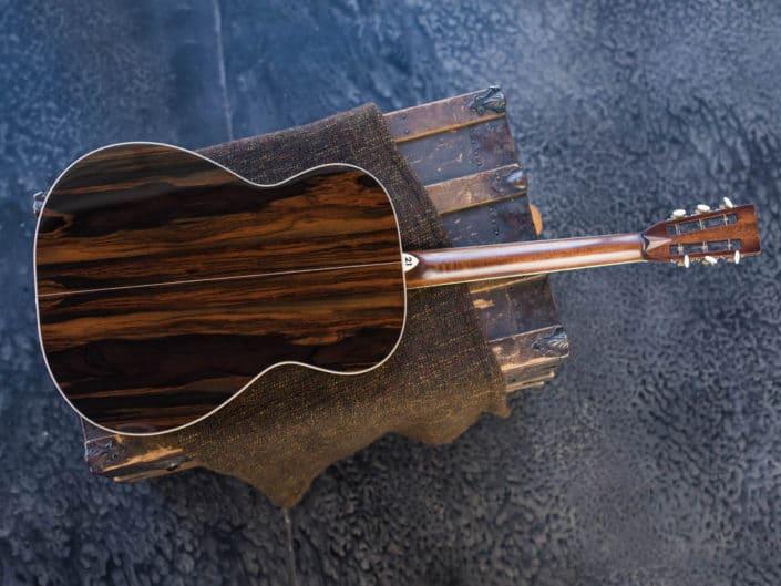 0000 model acoustic guitar